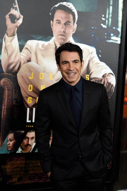 ". Chris Messina, a cast member in ""Live by Night,\"" poses at the premiere of the film \""Live by Night\"" at the TCL Chinese Theatre on Monday, Jan. 9, 2017 in Los Angeles. (Photo by Chris Pizzello/Invision/AP)"