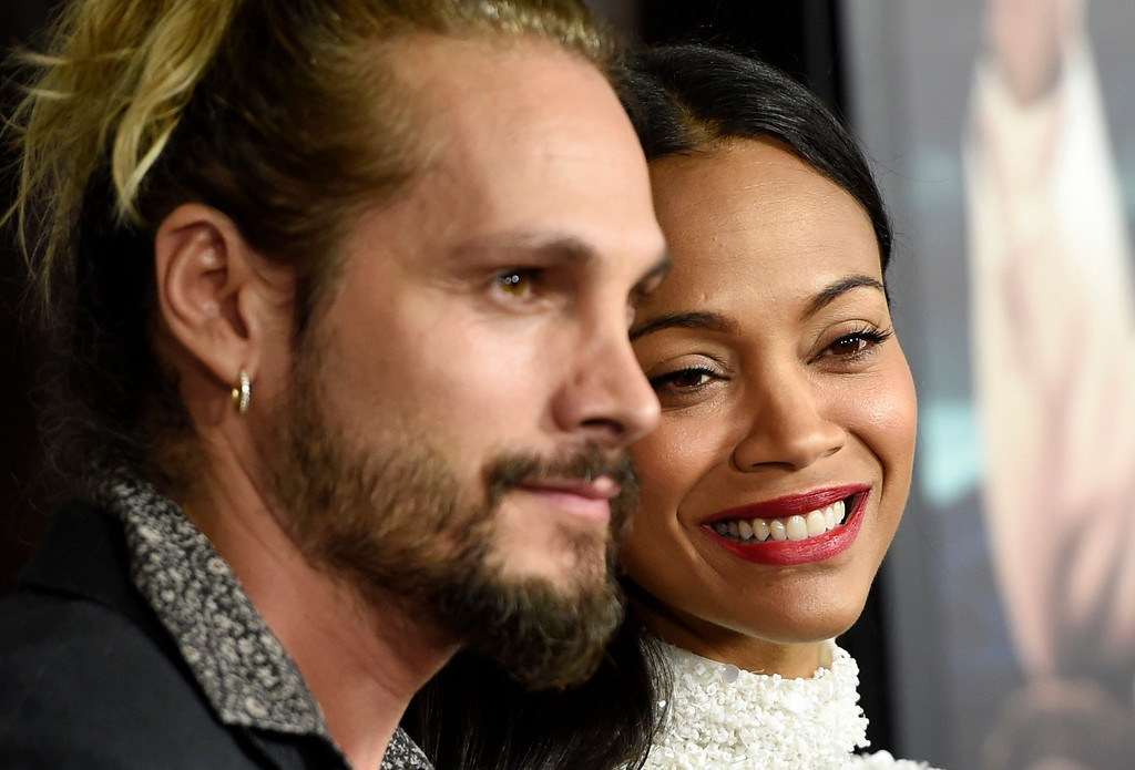 ". Zoe Saldana, right, a cast member in ""Live by Night,\"" and her husband Marco Perego pose together at the premiere of the film at the TCL Chinese Theatre on Monday, Jan. 9, 2017 in Los Angeles. (Photo by Chris Pizzello/Invision/AP)"