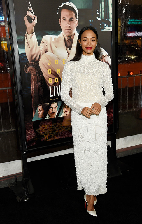 ". Zoe Saldana, a cast member in ""Live by Night,\"" poses at the premiere of the film at the TCL Chinese Theatre on Monday, Jan. 9, 2017 in Los Angeles. (Photo by Chris Pizzello/Invision/AP)"