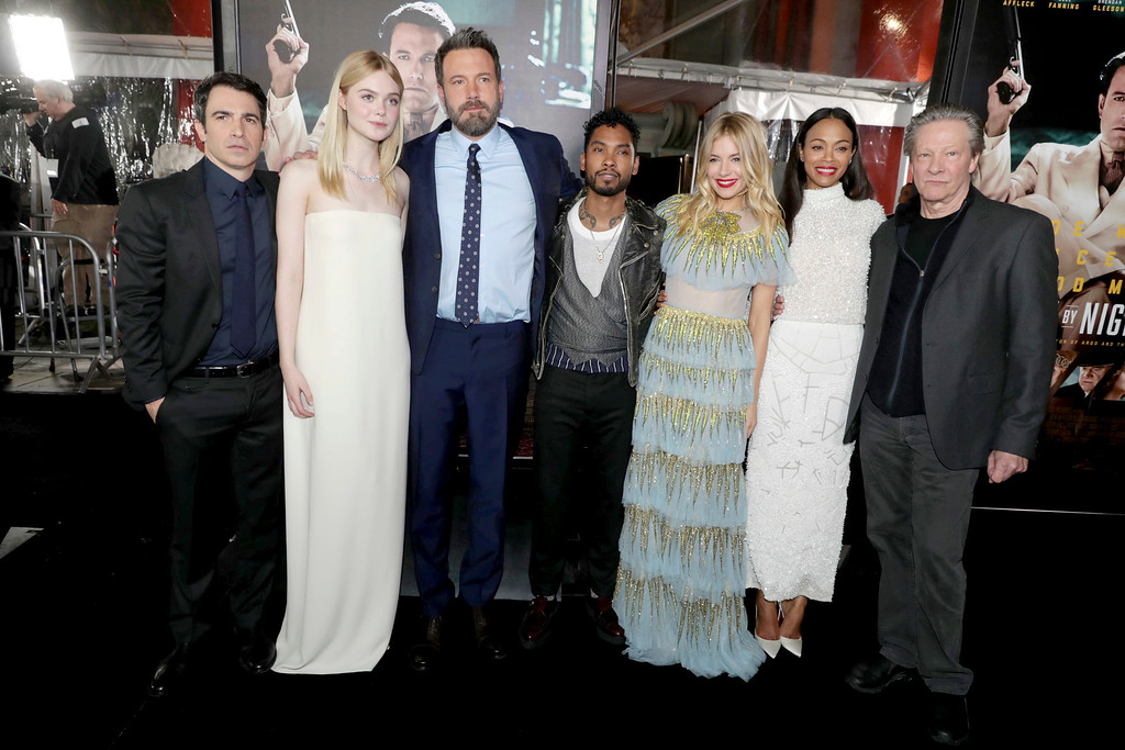 ". Chris Messina, Elle Fanning, Director/Writer/Producer/Actor Ben Affleck, Miguel, Sienna Miller, Zoe Saldana and Chris Cooper seen at the World Premiere of Warner Bros. ""Live by Night\"" at TCL Chinese Theater on Monday, Jan. 9, 2017, in Los Angeles. (Photo by Eric Charbonneau/Invision for Warner Bros./AP Images)"