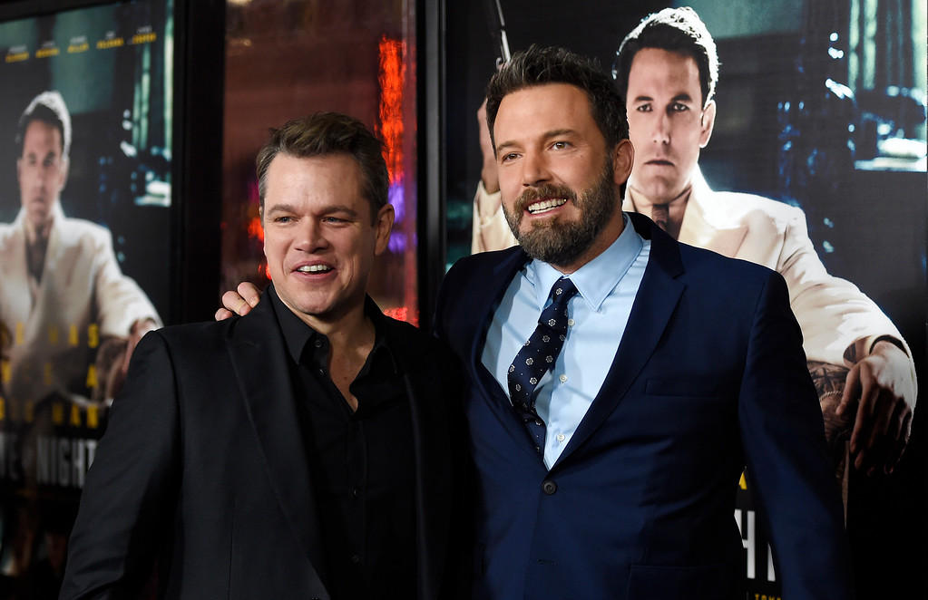 ". Ben Affleck, right, the director, writer, producer and star of ""Live by Night,\"" poses with actor Matt Damon at the premiere of the film at the TCL Chinese Theatre on Monday, Jan. 9, 2017 in Los Angeles. (Photo by Chris Pizzello/Invision/AP)"