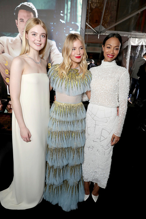 ". Elle Fanning, Sienna Miller and Zoe Saldana seen at the World Premiere of Warner Bros. ""Live by Night\"" at TCL Chinese Theater on Monday, Jan. 9, 2017, in Los Angeles. (Photo by Eric Charbonneau/Invision for Warner Bros./AP Images)"