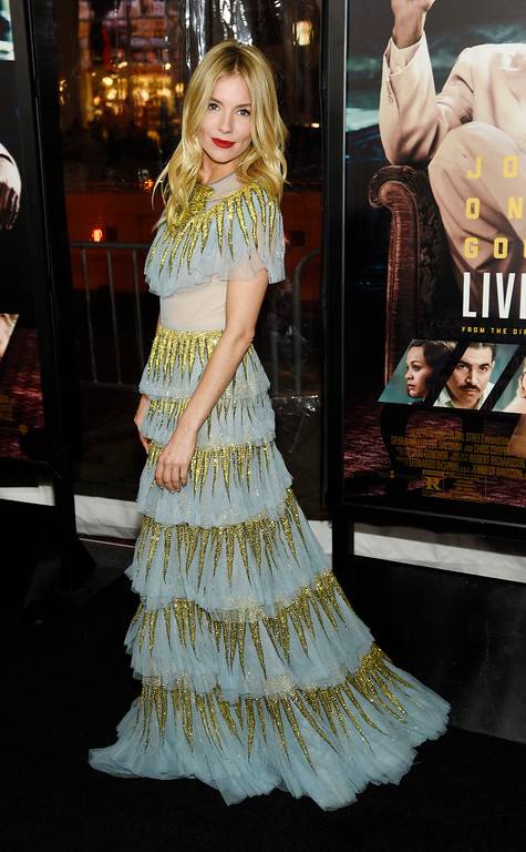 ". Sienna Miller, a cast member in ""Live by Night,\"" poses at the premiere of the film at the TCL Chinese Theatre on Monday, Jan. 9, 2017 in Los Angeles. (Photo by Chris Pizzello/Invision/AP)"