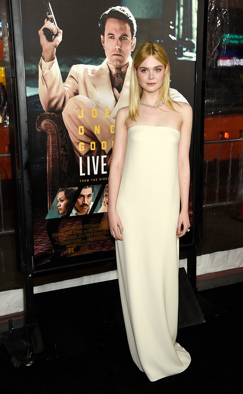 ". Elle Fanning, a cast member in ""Live by Night,\"" poses at the premiere of the film at the TCL Chinese Theatre on Monday, Jan. 9, 2017 in Los Angeles. (Photo by Chris Pizzello/Invision/AP)"