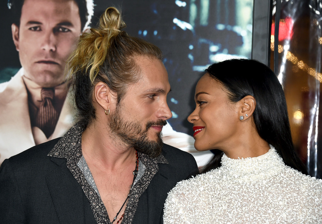 ". HOLLYWOOD, CA - JANUARY 09:  Artist Marco Perego and actress Zoe Saldana attend the premiere of Warner Bros. Pictures\' ""Live By Night\"" at TCL Chinese Theatre on January 9, 2017 in Hollywood, California.  (Photo by Frazer Harrison/Getty Images)"