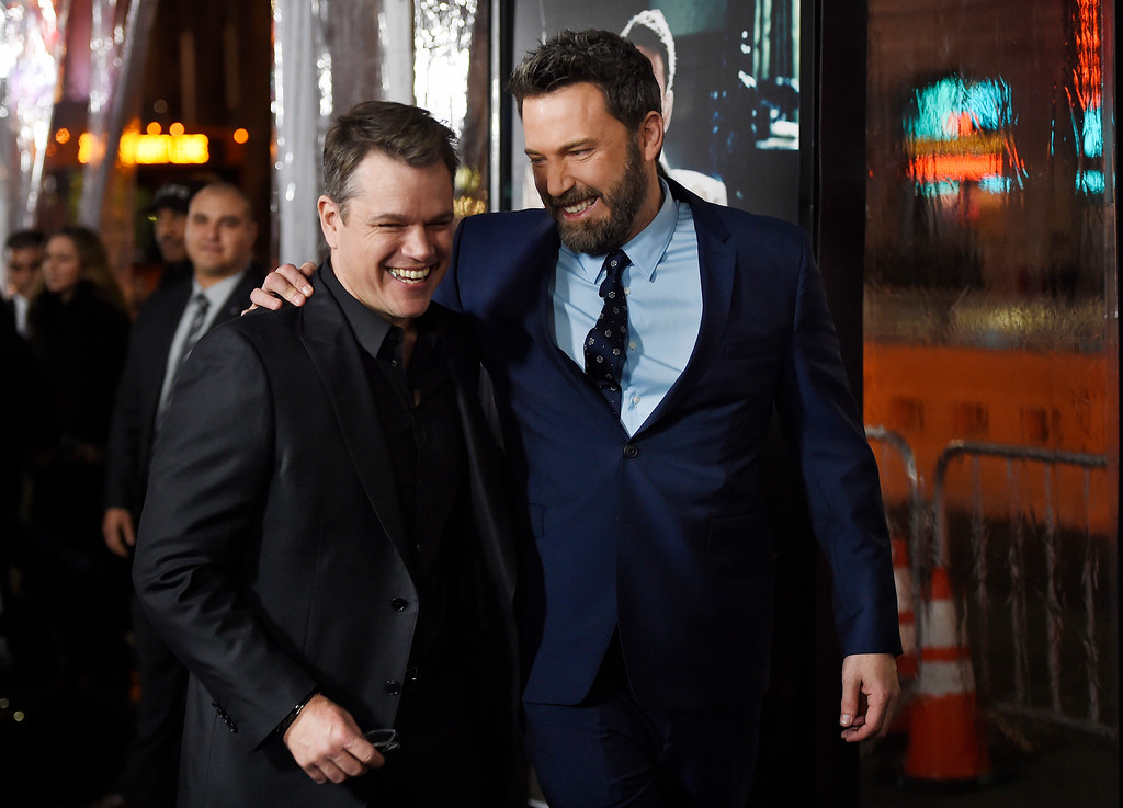 ". Ben Affleck, right, the director, writer, producer and star of ""Live by Night,\"" shares a laugh with actor Matt Damon at the premiere of the film at the TCL Chinese Theatre on Monday, Jan. 9, 2017 in Los Angeles. (Photo by Chris Pizzello/Invision/AP)"