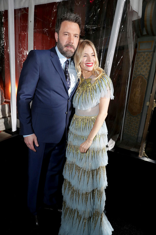 ". Director/Writer/Producer/Actor Ben Affleck and Sienna Miller seen at the World Premiere of Warner Bros. ""Live by Night\"" at TCL Chinese Theater on Monday, Jan. 9, 2017, in Los Angeles. (Photo by Eric Charbonneau/Invision for Warner Bros./AP Images)"