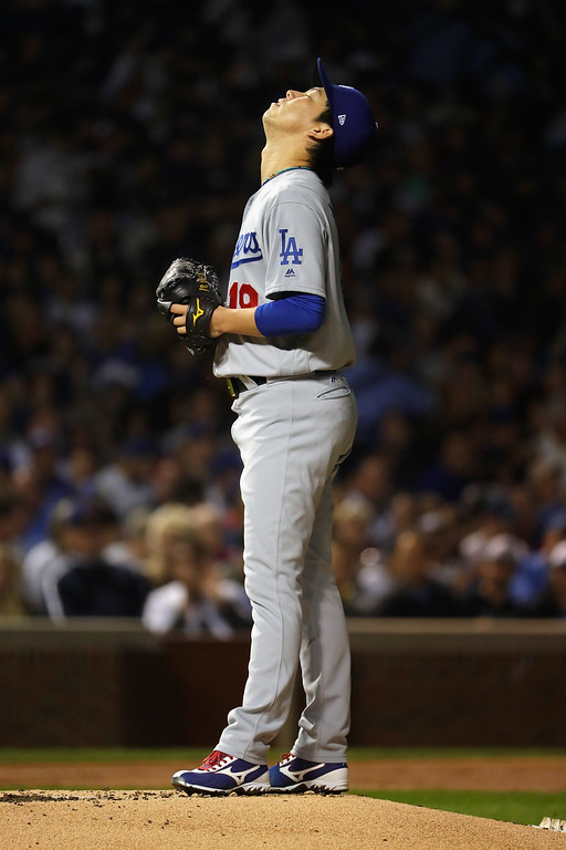 . CHICAGO, IL - OCTOBER 15:  Kenta Maeda #18 of the Los Angeles Dodgers prepares to pitch in the first inning against the Chicago Cubs during game one of the National League Championship Series at Wrigley Field on October 15, 2016 in Chicago, Illinois.  (Photo by Jamie Squire/Getty Images)