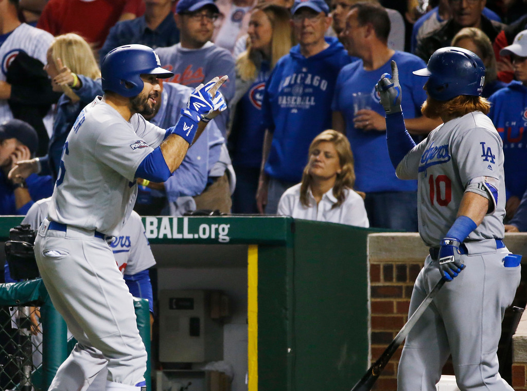 . Los Angeles Dodgers\' Andre Ethier (16) celebrates with Justin Turner (10) after hitting a home run during the fifth inning of Game 1 of the National League baseball championship series against the Chicago Cubs Saturday, Oct. 15, 2016, in Chicago. (AP Photo/Nam Y. Huh)