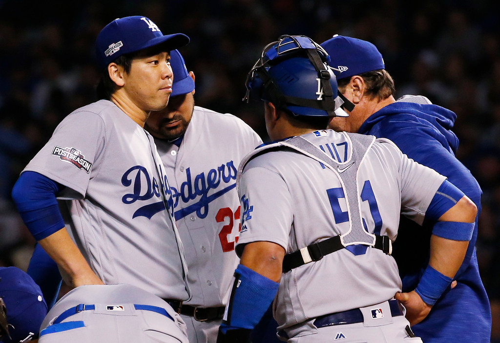 . Los Angeles Dodgers pitching coach Rick Honeycutt, right talks to starting pitcher Kenta Maeda (18) during the fourth inning of Game 1 of the National League baseball championship series against the Chicago Cubs Saturday, Oct. 15, 2016, in Chicago. (AP Photo/Nam Y. Huh)