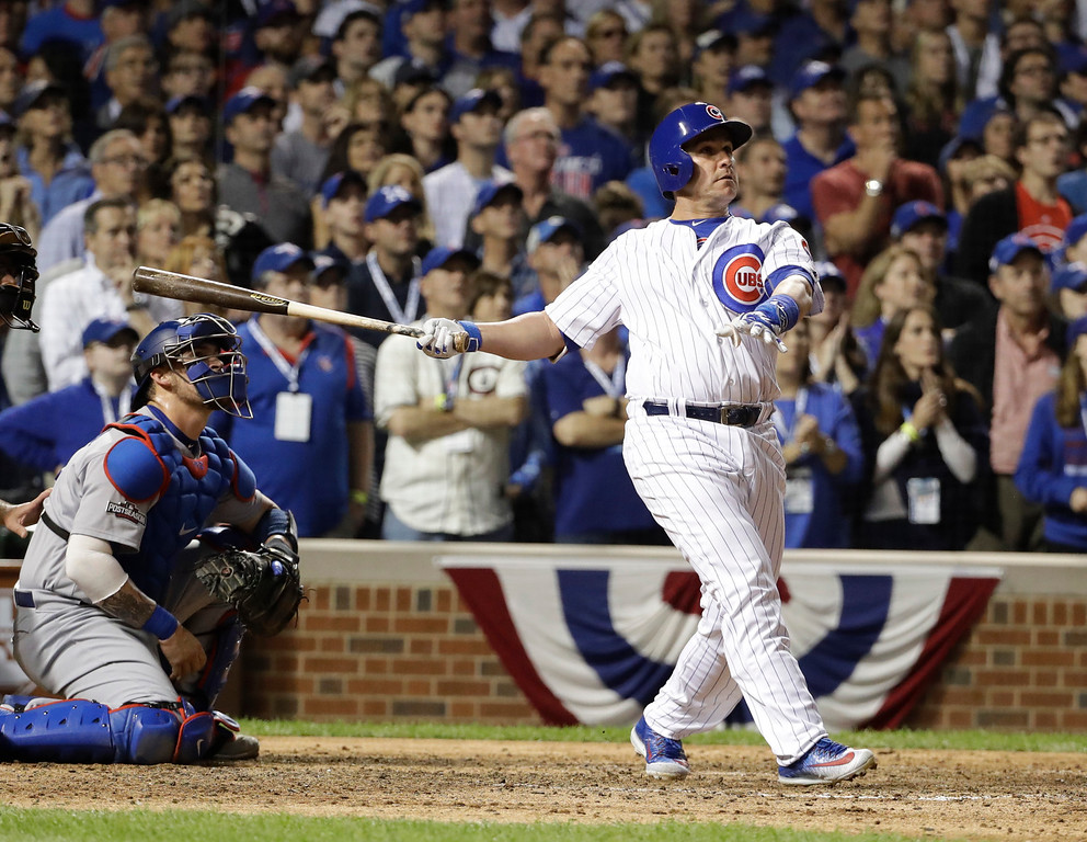 . Chicago Cubs catcher Miguel Montero (47) watch the ball as he hits a grand slam during the eighth inning of Game 1 of the National League baseball championship series against the Los Angeles Dodgers Saturday, Oct. 15, 2016, in Chicago. (AP Photo/David J. Phillip)