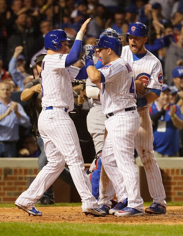 . CHICAGO, IL - OCTOBER 15:  Miguel Montero #47 of the Chicago Cubs celebrates with Chris Coghlan #8 and Ben Zobrist #18 after hitting a grand slam home run in the eighth inning against the Los Angeles Dodgers during game one of the National League Championship Series at Wrigley Field on October 15, 2016 in Chicago, Illinois.  (Photo by Jamie Squire/Getty Images)