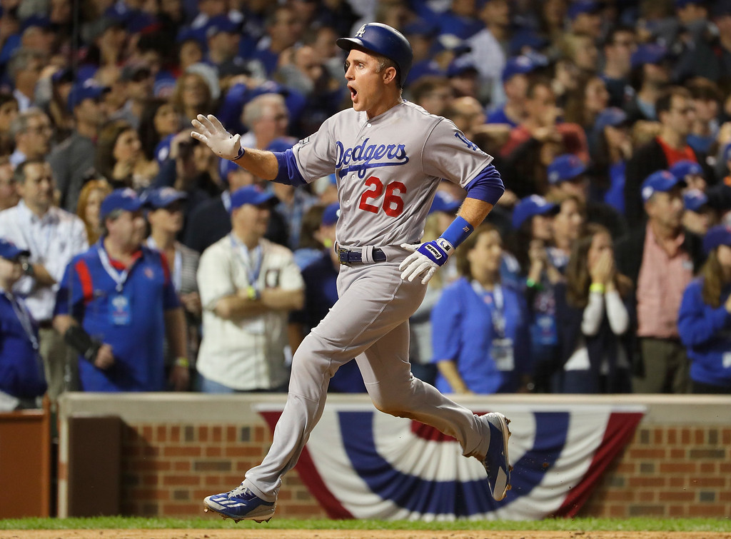 . CHICAGO, IL - OCTOBER 15:  Chase Utley #26 of the Los Angeles Dodgers celebrates scoring a run on a two-run RBI single hit by Adrian Gonzalez #23 (not pictured) in the eighth inning against the Chicago Cubs during game one of the National League Championship Series at Wrigley Field on October 15, 2016 in Chicago, Illinois.  (Photo by Jamie Squire/Getty Images)