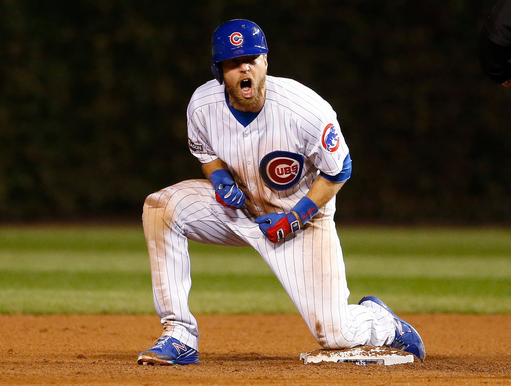 . Chicago Cubs\' Ben Zobrist reacts after hitting a double during the eighth inning of Game 1 of the National League baseball championship series against the Los Angeles Dodgers Saturday, Oct. 15, 2016, in Chicago. (AP Photo/Nam Y. Huh)