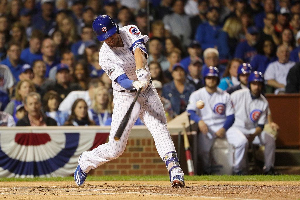 . CHICAGO, IL - OCTOBER 15:  Kris Bryant #17 of the Chicago Cubs hits an RBI double to score Dexter Fowler #24 (not pictured) in the first inning against the Los Angeles Dodgers during game one of the National League Championship Series at Wrigley Field on October 15, 2016 in Chicago, Illinois.  (Photo by Jamie Squire/Getty Images)