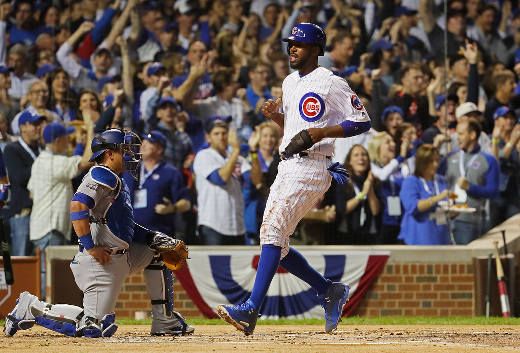 . CHICAGO, IL - OCTOBER 15:  Dexter Fowler #24 of the Chicago Cubs scores a run in the first inning against the Los Angeles Dodgers during game one of the National League Championship Series at Wrigley Field on October 15, 2016 in Chicago, Illinois.  (Photo by Jamie Squire/Getty Images)