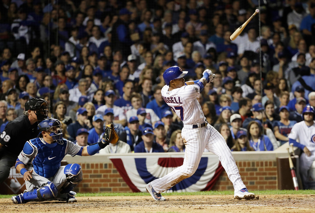. Chicago Cubs\' Addison Russell (27) loses his bat during the fifth inning of Game 1 of the National League baseball championship series against the Los Angeles Dodgers Saturday, Oct. 15, 2016, in Chicago. (AP Photo/David J. Phillip)