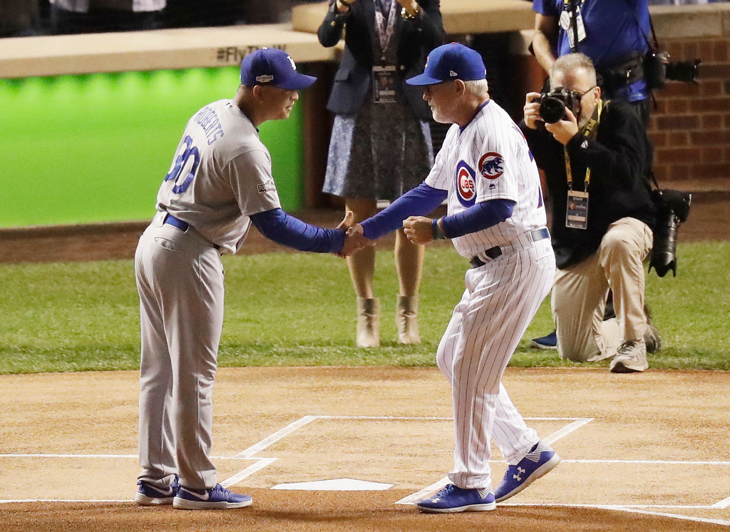 . Los Angeles Dodgers manager Dave Roberts (30) and Chicago Cubs manager Joe Maddon (70) shake hands before Game 1 of the National League baseball championship series Saturday, Oct. 15, 2016, in Chicago. (AP Photo/Charles Rex Arbogast)