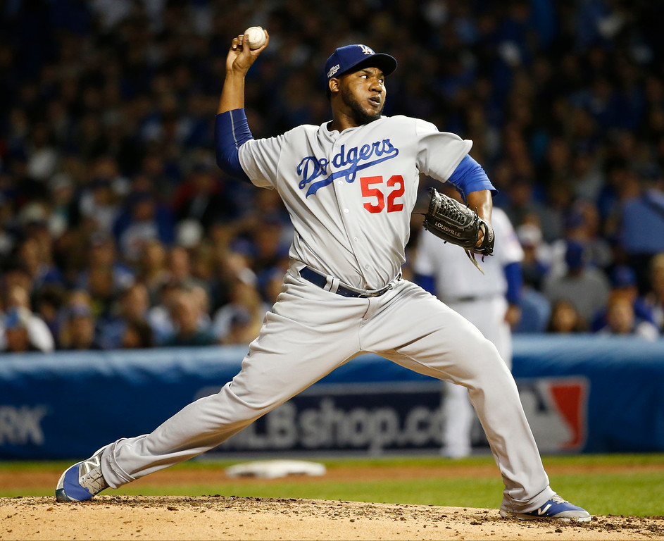 . Los Angeles Dodgers relief pitcher Pedro Baez (52) throws during the fifth inning of Game 1 of the National League baseball championship series against the Chicago Cubs Saturday, Oct. 15, 2016, in Chicago. (AP Photo/Nam Y. Huh)