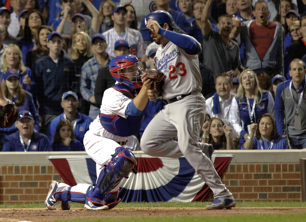 . Chicago Cubs catcher David Ross (3) tags out Los Angeles Dodgers\' Adrian Gonzalez (23) during the second inning of Game 1 of the National League baseball championship series Saturday, Oct. 15, 2016, in Chicago. (AP Photo/David J. Phillip)