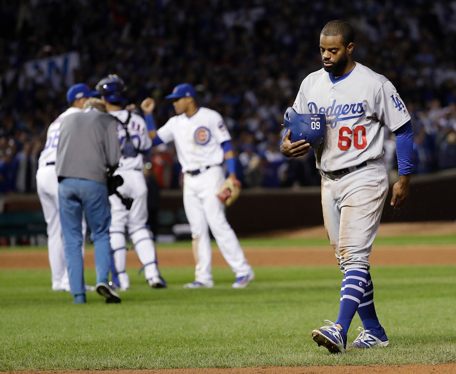 . Los Angeles Dodgers\' Andrew Toles (60) walks off the field after Game 1 of the National League baseball championship series against the Chicago Cubs Saturday, Oct. 15, 2016, in Chicago. Cubs won 8-4 to take a 1-0 lead in the series. Cubs won 8-4 to take a 1-0 lead in the series. (AP Photo/David J. Phillip)