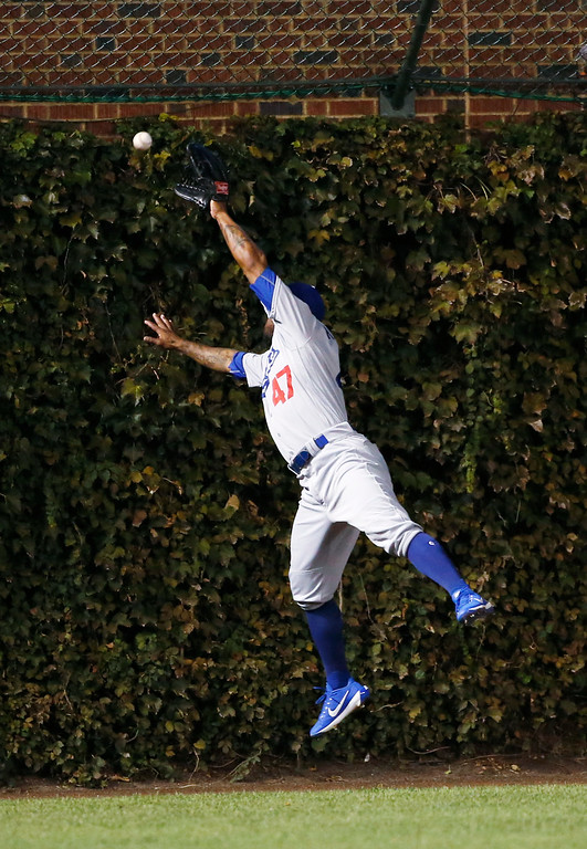 . Los Angeles Dodgers left fielder Howie Kendrick (47) can\'t catch a RBI double by Chicago Cubs third baseman Kris Bryant (17) during the first inning of Game 1 of the National League baseball championship series Saturday, Oct. 15, 2016, in Chicago. (AP Photo/Nam Y. Huh)