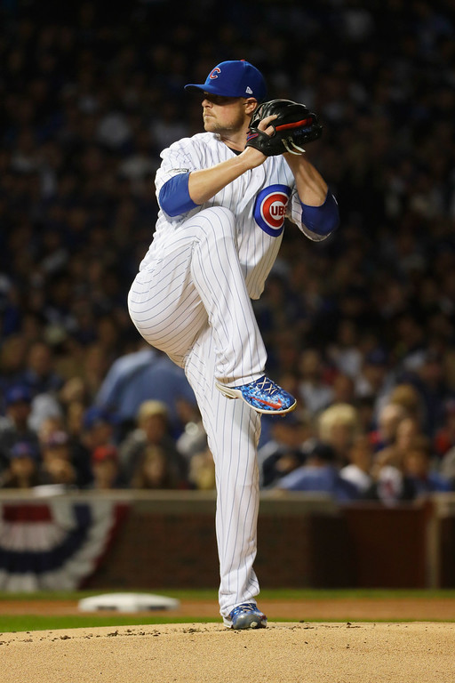 . CHICAGO, IL - OCTOBER 15:  Jon Lester #34 of the Chicago Cubs pitches in the first inning against the Los Angeles Dodgers during game one of the National League Championship Series at Wrigley Field on October 15, 2016 in Chicago, Illinois.  (Photo by Jamie Squire/Getty Images)