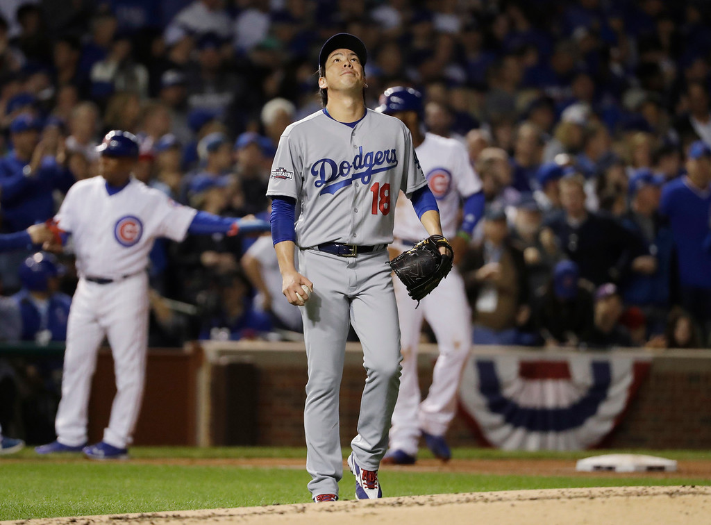 . Los Angeles Dodgers starting pitcher Kenta Maeda (18) reacts after Chicago Cubs right fielder Jason Heyward (22) hits a triple during the second inning of Game 1 of the National League baseball championship series Saturday, Oct. 15, 2016, in Chicago. (AP Photo/David J. Phillip)