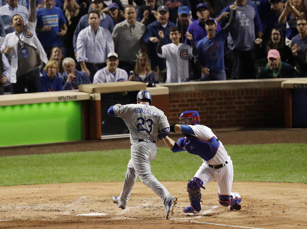 . Chicago Cubs catcher David Ross tags out Los Angeles Dodgers\' Adrian Gonzalez (23) during the second inning of Game 1 of the National League baseball championship series Saturday, Oct. 15, 2016, in Chicago. (AP Photo/Charles Rex Arbogast)