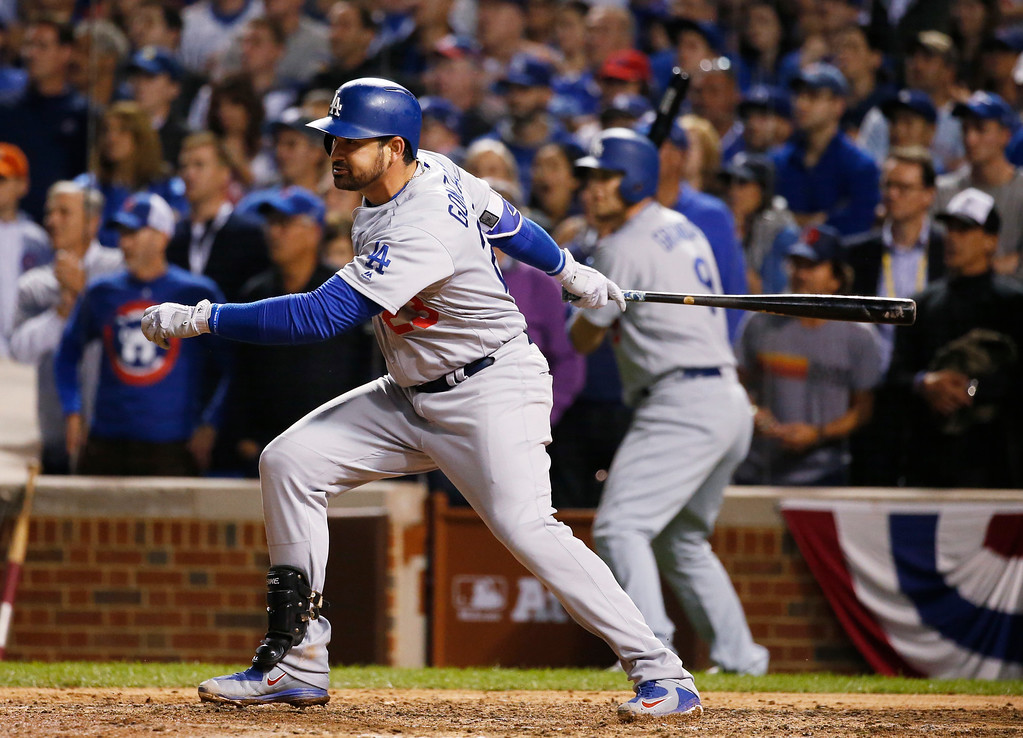 . Los Angeles Dodgers\' Adrian Gonzalez (23) hits a two-run scoring single during the eighth inning of Game 1 of the National League baseball championship series against the Chicago Cubs Saturday, Oct. 15, 2016, in Chicago. (AP Photo/Nam Y. Huh)