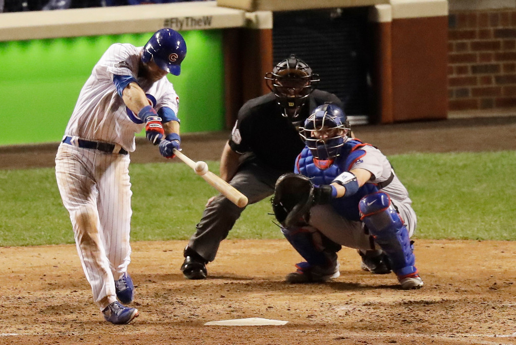 . Chicago Cubs\' Ben Zobrist (18) hits a double during the eighth inning of Game 1 of the National League baseball championship series against the Los Angeles Dodgers Saturday, Oct. 15, 2016, in Chicago. (AP Photo/Charles Rex Arbogast)