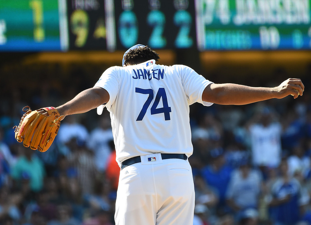 . LOS ANGELES, CA - AUGUST 28:  Kenley Jansen #74 of the Los Angeles Dodgers stretches before throwing the final pitch of the game against the Chicago Cubs where he earned his 39th save at Dodger Stadium on August 28, 2016 in Los Angeles, California. The Los Angeles Dodgers defeated the Chicago Cubs 1-0.  (Photo by Jayne Kamin-Oncea/Getty Images)