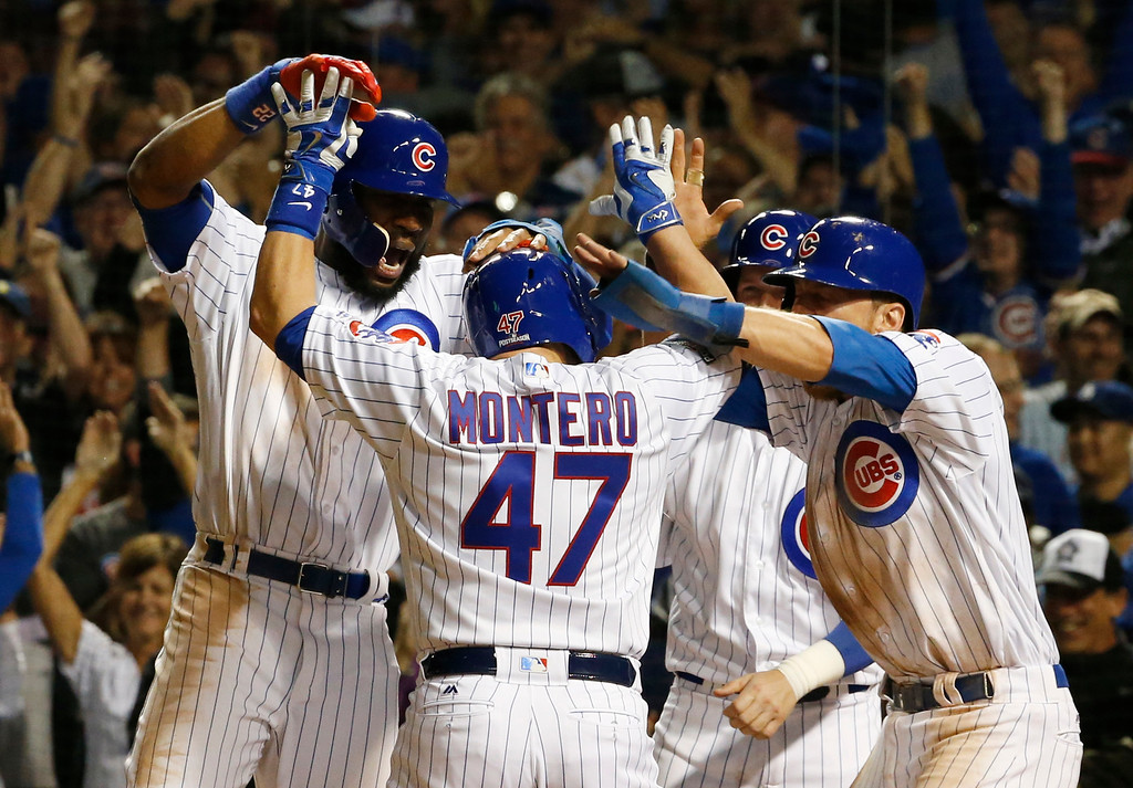 . Chicago Cubs\' Miguel Montero (47) celebrates a grand slam during the eighth inning of Game 1 of the National League baseball championship series against the Los Angeles Dodgers Saturday, Oct. 15, 2016, in Chicago. (AP Photo/Nam Y. Huh)