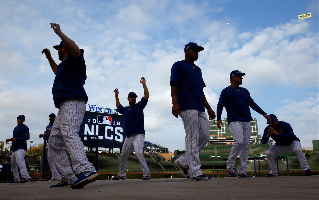 . Chicago Cubs players warm up during batting practice before Game 1 of baseball\'s National League Championship Series against the Los Angeles Dodgers, Saturday, Oct. 15, 2016, in Chicago. (AP Photo/Nam Y. Huh)
