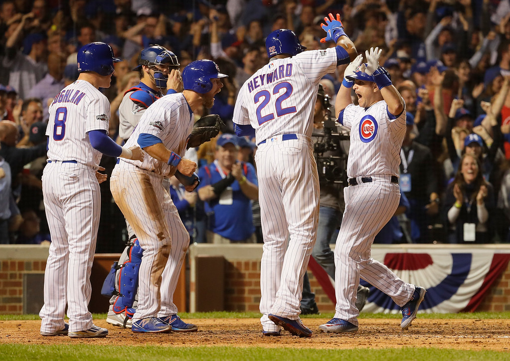 . CHICAGO, IL - OCTOBER 15:  Miguel Montero #47 of the Chicago Cubs celebrates with Jason Heyward #22, Chris Coghlan #8 and Ben Zobrist #18 after hitting a grand slam home run in the eighth inning against the Los Angeles Dodgers during game one of the National League Championship Series at Wrigley Field on October 15, 2016 in Chicago, Illinois.  (Photo by Jamie Squire/Getty Images)