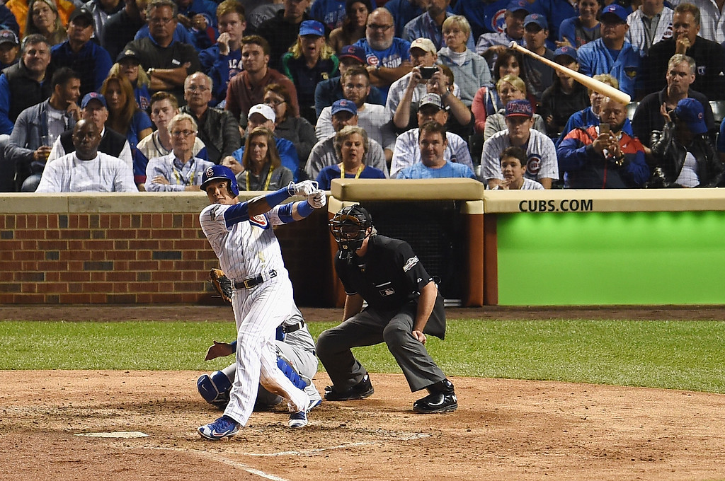 . CHICAGO, IL - OCTOBER 15:  Addison Russell #27 of the Chicago Cubs loses his bat in the fifth inning against the Los Angeles Dodgers during game one of the National League Championship Series at Wrigley Field on October 15, 2016 in Chicago, Illinois.  (Photo by Stacy Revere/Getty Images)