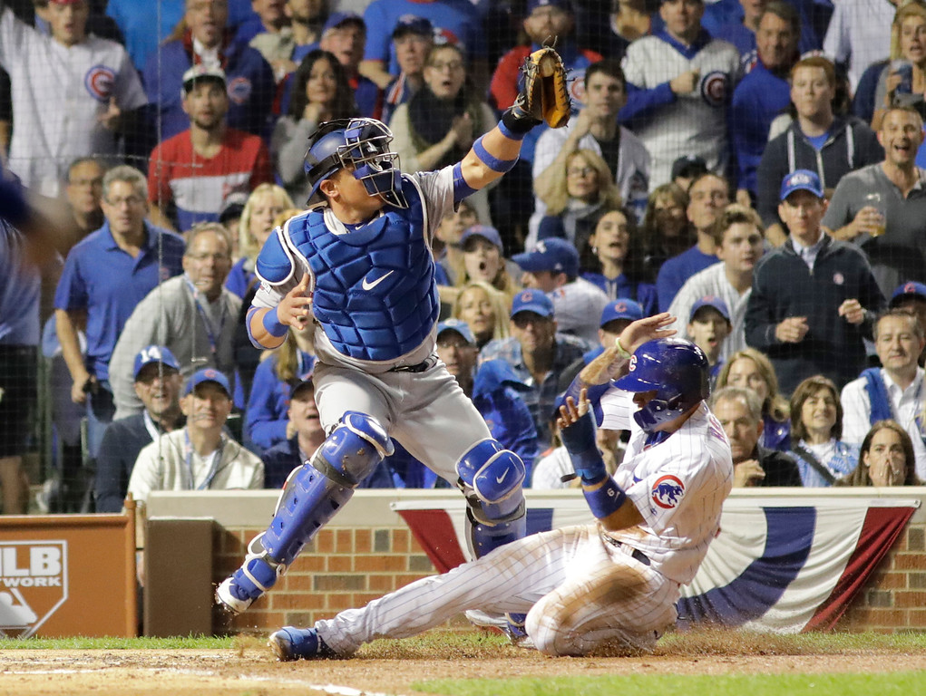 . Chicago Cubs\' Javier Baez (9) steals home against Los Angeles Dodgers catcher Carlos Ruiz (51) during the second inning of Game 1 of the National League baseball championship series Saturday, Oct. 15, 2016, in Chicago. (AP Photo/David J. Phillip)