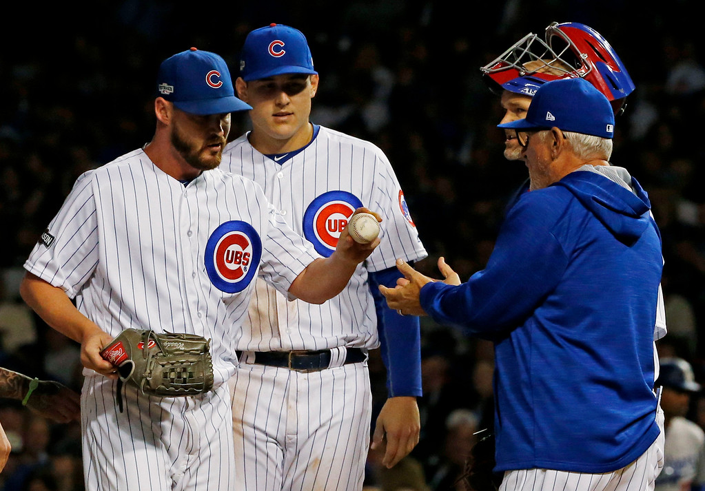 . Chicago Cubs manager Joe Maddon takes the ball from relief pitcher Travis Wood during the seventh inning of Game 1 of the National League baseball championship series against the Los Angeles Dodgers Saturday, Oct. 15, 2016, in Chicago. (AP Photo/Nam Y. Huh)