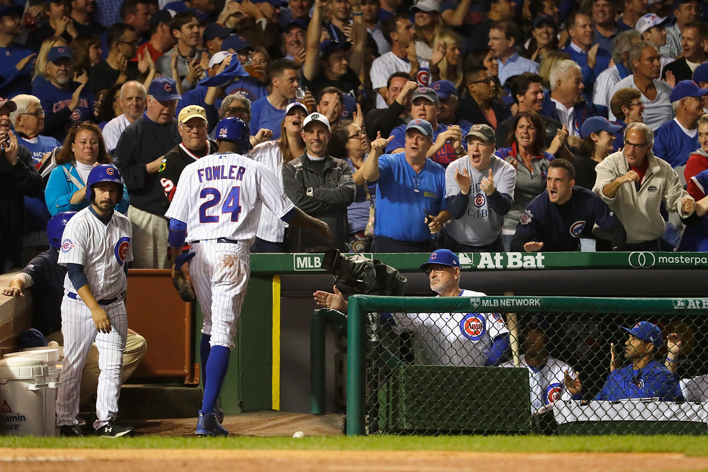 . CHICAGO, IL - OCTOBER 15:  Dexter Fowler #24 of the Chicago Cubs celebrates at the dugout with manager Joe Maddon after scoring a run in the first inning against the Los Angeles Dodgers during game one of the National League Championship Series at Wrigley Field on October 15, 2016 in Chicago, Illinois.  (Photo by Jamie Squire/Getty Images)