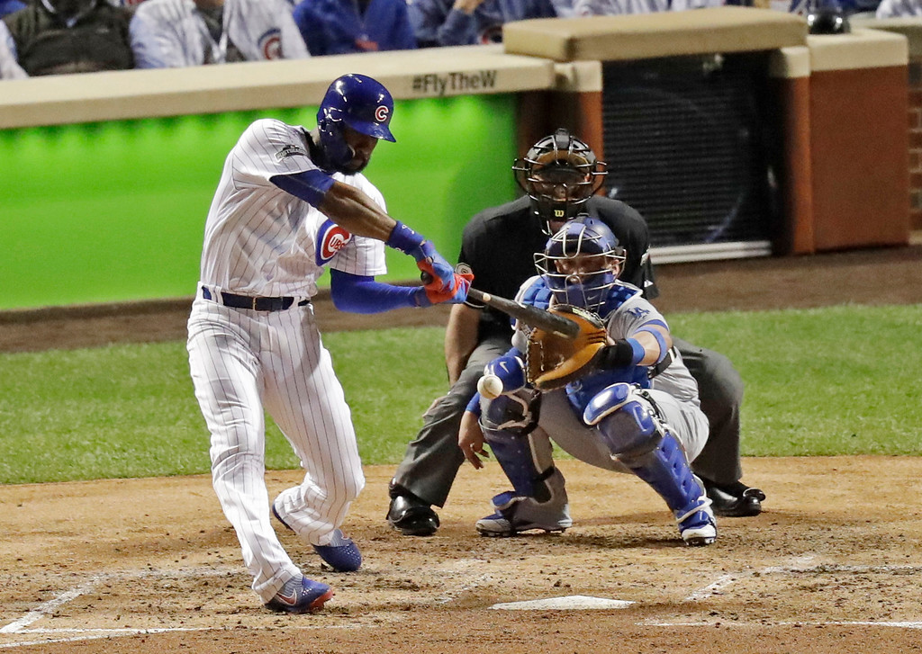 . Chicago Cubs right fielder Jason Heyward (22) hits a triple during the second inning of Game 1 of the National League baseball championship series Saturday, Oct. 15, 2016, in Chicago. (AP Photo/Charles Rex Arbogast)