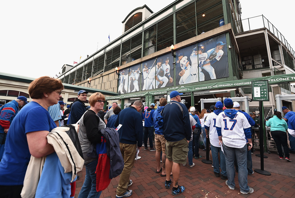 . CHICAGO, IL - OCTOBER 15:  Fans enter Wrigley Field prior to game one of the National League Championship Series between the Chicago Cubs and the Los Angeles Dodgers on October 15, 2016 in Chicago, Illinois.  (Photo by Stacy Revere/Getty Images)