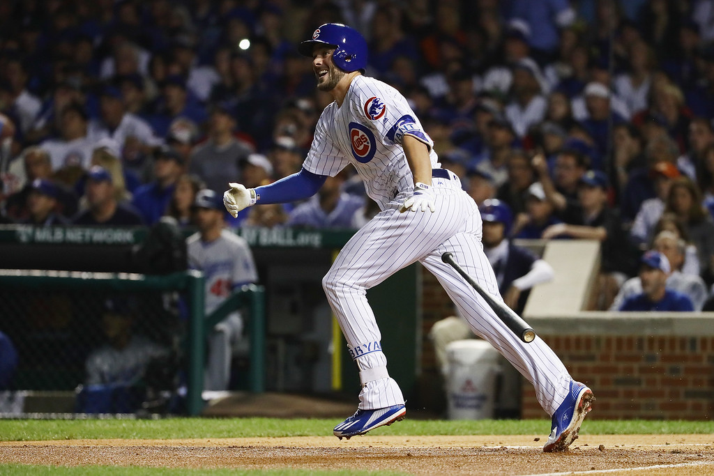 . CHICAGO, IL - OCTOBER 15:  Kris Bryant #17 of the Chicago Cubs tosses his bat after hitting an RBI double to score Dexter Fowler #24 (not pictured) in the first inning against the Los Angeles Dodgers during game one of the National League Championship Series at Wrigley Field on October 15, 2016 in Chicago, Illinois.  (Photo by Jonathan Daniel/Getty Images)