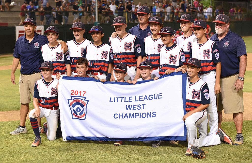 . Santa Margarita Little League team members hold up their West Championship flag. (Photo by Bill Alkofer, Orange County Register/SCNG)