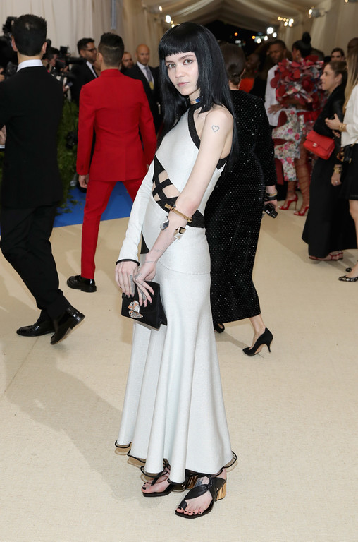 """. NEW YORK, NY - MAY 01:  Grimes attends the \""""Rei Kawakubo/Comme des Garcons: Art Of The In-Between\"""" Costume Institute Gala at Metropolitan Museum of Art on May 1, 2017 in New York City.  (Photo by Neilson Barnard/Getty Images)"""