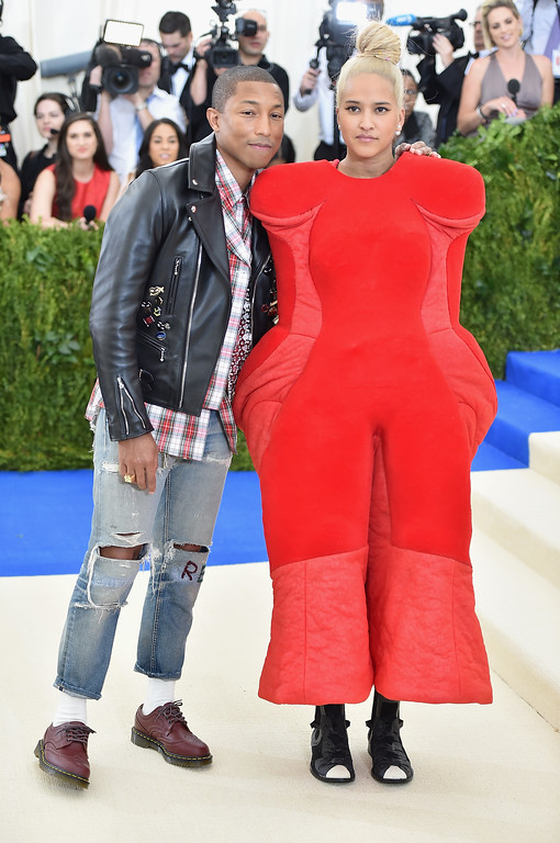 """. NEW YORK, NY - MAY 01:  Pharrell Williams (L) and  Helen Lasichanh attend the \""""Rei Kawakubo/Comme des Garcons: Art Of The In-Between\"""" Costume Institute Gala at Metropolitan Museum of Art on May 1, 2017 in New York City.  (Photo by Theo Wargo/Getty Images For US Weekly)"""