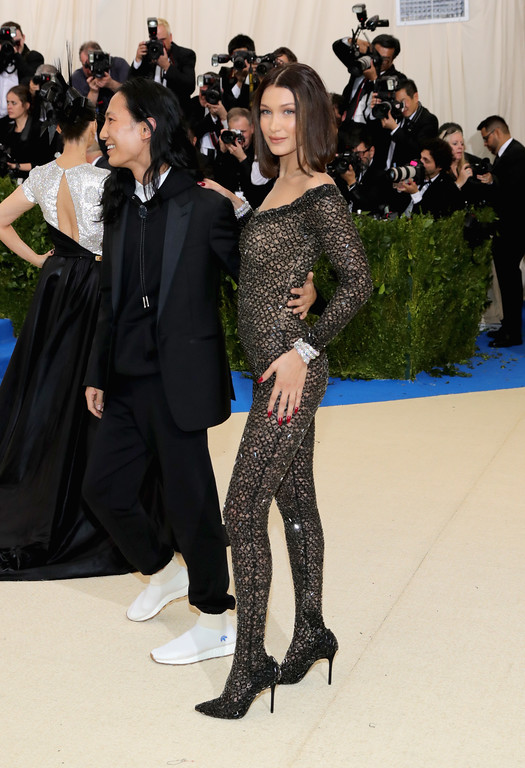 """. NEW YORK, NY - MAY 01:  Alexander Wang and Bella Hadid attend the \""""Rei Kawakubo/Comme des Garcons: Art Of The In-Between\"""" Costume Institute Gala at Metropolitan Museum of Art on May 1, 2017 in New York City.  (Photo by Neilson Barnard/Getty Images)"""
