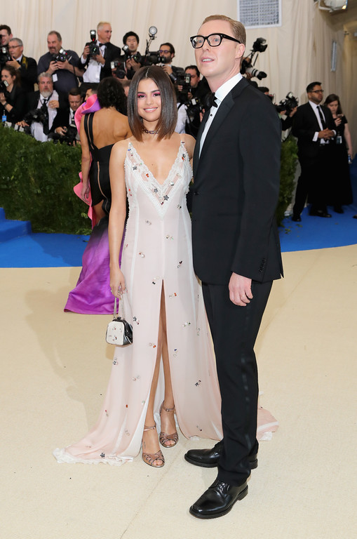 """. NEW YORK, NY - MAY 01:  Selena Gomez (L) and designer Stuart Vevers attend the \""""Rei Kawakubo/Comme des Garcons: Art Of The In-Between\"""" Costume Institute Gala at Metropolitan Museum of Art on May 1, 2017 in New York City.  (Photo by Neilson Barnard/Getty Images)"""