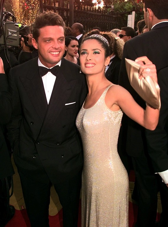. Actress Salma Hayek and singer Luis Miguel smile as they arrive for the 69th Annual Academy Awards at the Shrine Auditorium in Los Angeles, Monday, March 24, 1997. (AP Photo/Mark J. Terrill)