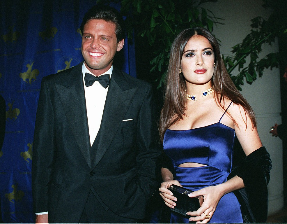 . Latin singer Luis Miguel and Salma Hayek arrive at the Carousel of Hope gala at the Beverly Hills Hotel in Beverly Hills, Calif., Friday, Oct. 25, 1996.  (AP Photo/Kevork Djansezian)