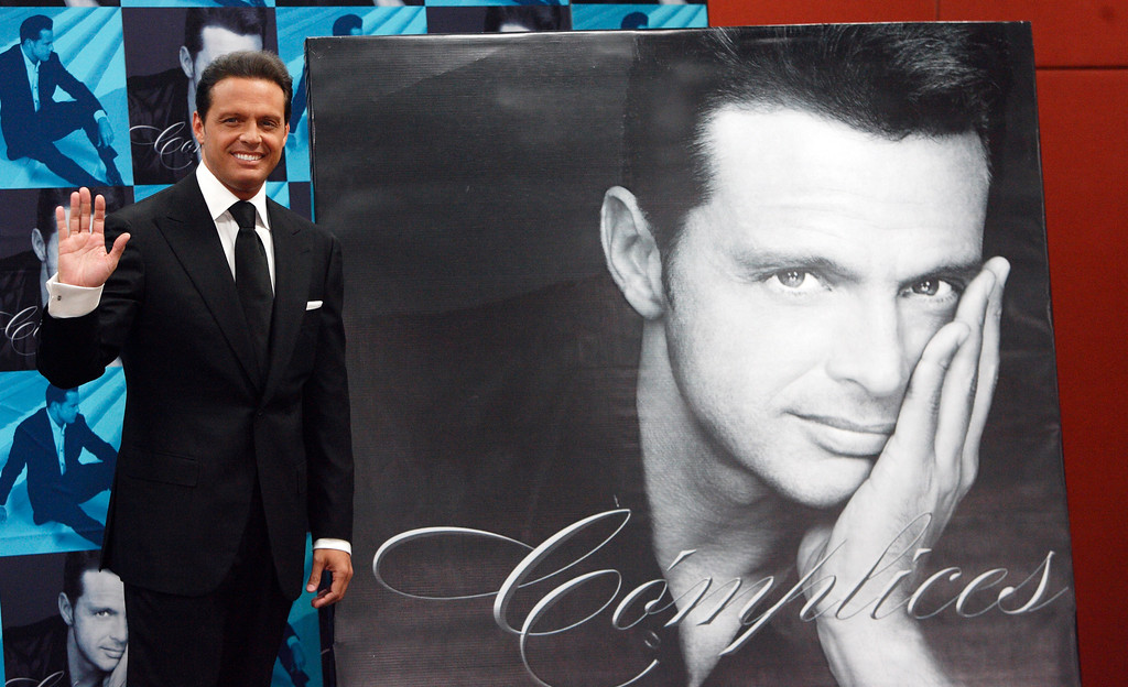 . Singer Luis Miguel poses for photographers in Mexico City Tuesday, May 6, 2008. (AP Photo/Gregory Bull)